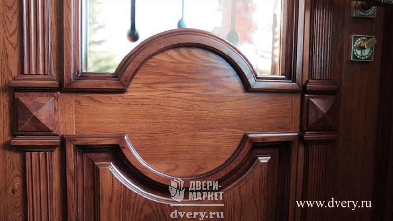 эксклюзивные входные двери с отделкой массив дуба